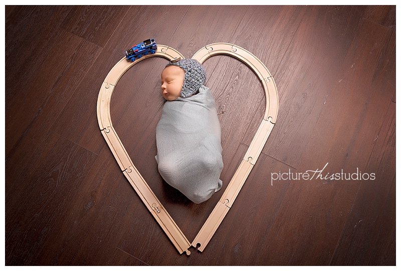 newborn with heart train tracks