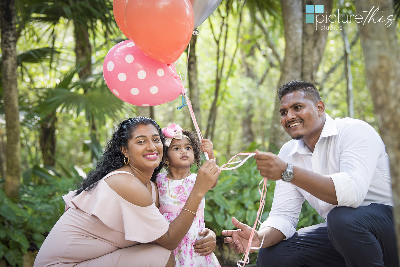 This beautiful little two year old celebrated with family portraits at The Cayman Islands Botanical Park by Heather Holt Photography with Picture This Studios