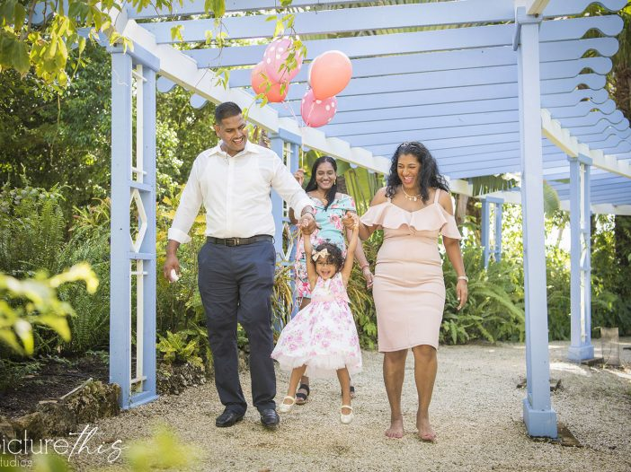 This beautiful little two year old celebrated with family portraits at The Cayman Islands Botanical Park by Heather Holt Photography with Picture This Studios.